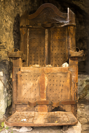 wooden chair with nails for witches used to extreme torture