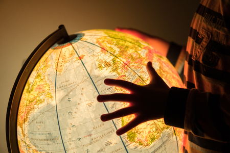 looking for a location on an earth model map Stock Photo
