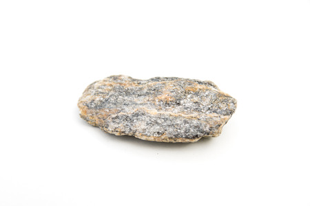 close up of gneiss stone isolated over white background