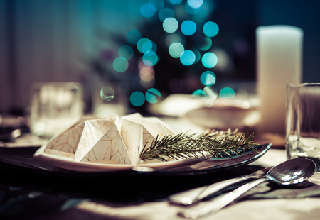 elegant table setting with decoration for dinner in regular home