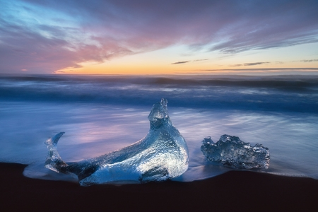 Beautiful sunset over the famous Diamond beach, Iceland. Jokulsarlon glacial ice gems ice glacier glacial ice glacier glacial ice glacier glacial ice glacier Stok Fotoğraf