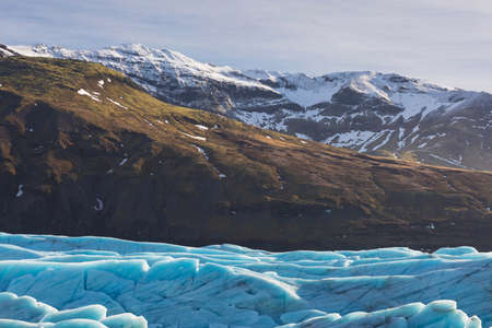 Beautiful glaciers flow through the mountains in Iceland. Stock fotó