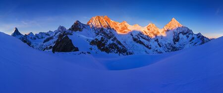View of snow covered landscape with Dent Blanche mountains and Weisshorn mountain in Swiss Alps near Zermatt. Panorama of Weisshorn and surrounding mountains in Switzerland. Beautiful morning