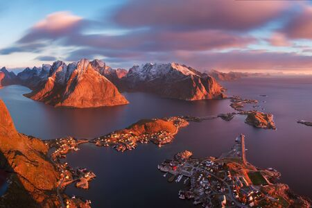 Sunset or sunrise panoramic view on stunning mountains in Lofoten islands, Norway, Mountain coast landscape, Arctic circle. Long exposure of magic sunrise during last winter. Christmas time