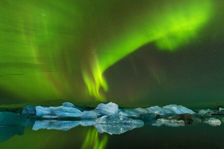 Beautiful panoramic Aurora Borealis or better known as Northern Lights for background view in Iceland, Jokulsarlon during winter Dreamy atmosphere. Happy New Year 免版税图像