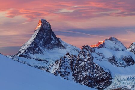 Matterhorn during winter. It is a mountain of the Alps, straddling the main watershed and border between Switzerland and Italy.Beautiful mountain landscape with views of the Matterhorn peak in Zermatt