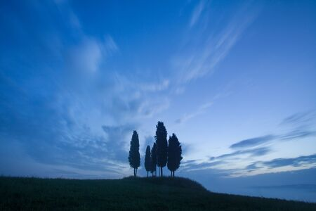 Tuscany landscape at sunrise. Typical for the region of Tuscan Farm House, Hills, Vineyard. Italy Fresh Green Tuscany Landscape in Spring Time. Beautiful foggy landscape concept