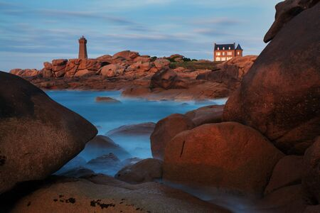 Ploumanach Mean Ruz lighthouse at sunset, Perros Guirec, Brittany, France