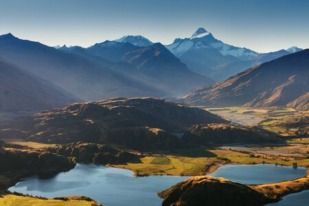 Panorama of Roys Peak between Wanaka and Queenstown with lake and Mount Aspiring and cook in New Zealand alps on background Summer season in tourist resort. New Zealand