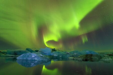 Beautiful aurora borealis | Sky with stars and green polar lights. Night landscape with Aurora. Concept. Nature background Banco de Imagens