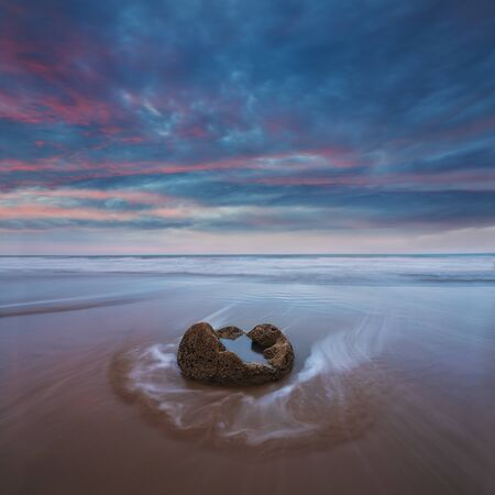 Sunset and long exposure and dramatic dawn sky. Archivio Fotografico