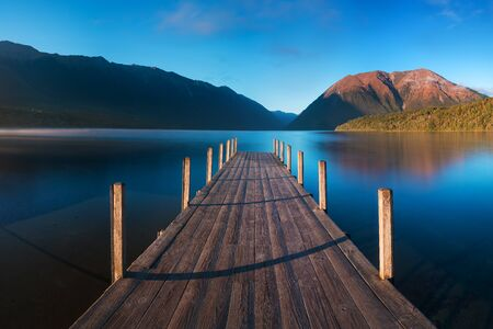 A romantic wharf on Lake Rotoiti, view of the Saint Arnaud Ridge mist