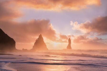 Reynisdrangar cliffs near Vik town. Dramatic landscape with Atlantic Ocean. Tourist attraction of Iceland. Rock formations on Black Beach. Reynisfjara Beach at sunrise, Halsanefhellir