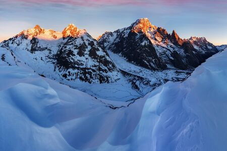Mont Blanc massif and his melting glaciers. Winter adventures in the French Alps. Courmayeur dating in Aosta Valley. Italy Val Veny, and ski slopes of Courmayeur ski domain. Christmas time