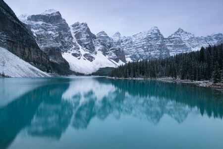 Morning snow at Moraine Lake in Banff National Park Alberta Canada Snow covered winter mountain lake in winter. Beautiful background photo