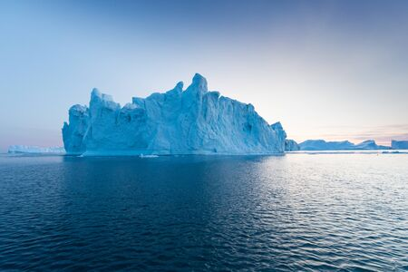 Greenland or Antarctica. Travel on ship among ices. Studying of global warming phenomenon Ices and icebergs of unusual forms and colors