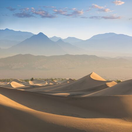 Early Morning Sunlight Over Sand Dunes And Mountains At Mesquite Flat Dunes, Death Valley National Park, California USA Stovepipe Wells Sand Dunes, Very Nice Structures In Sand