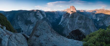 Half Dome and Yosemite Valley in Yosemite National Park during colorful sunset with trees and rocks. California, USA Sunny day at the most popular viewpoint in Yosemite. Beautiful landscape background 版權商用圖片