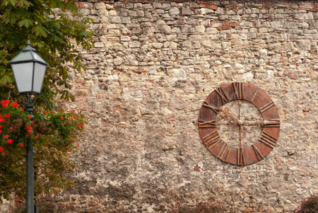Old clock on the wall, Zagreb, Croatia photo