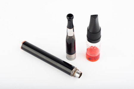 e cig: Photo of electronic Cigarette and liquid against white background Stock Photo