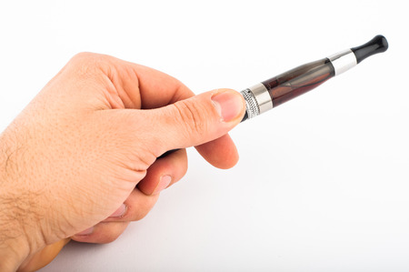 Photo of hand with electronic cigarette agains white background