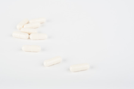 doses: Photo of medicine pills on white background