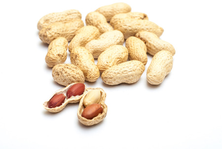 nutshells: Photo of peanuts on white with soft shadow.