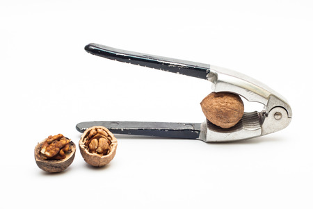 nut cracker: Group of walnuts with cracker against white background Stock Photo