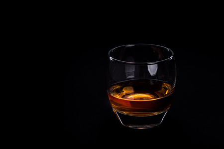 whisky glass: Photo of whisky glass against black background