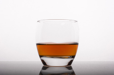 liquor glass: Photo of whisky in the glass against white background