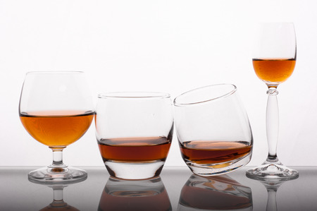 liquor glass: Photo of different glass of whisky against white background Stock Photo