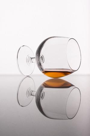 cognac: Photo of cognac glass against white background