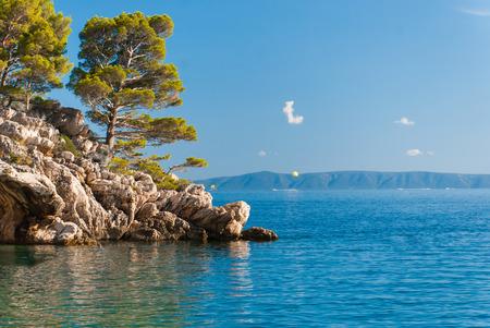 riviera: Photo of wild rock beach in Brela, Makarska Riviera, Croatia