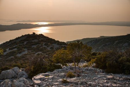 kornati: Photo of sunset above Vransko Lake and Kornati Islands. View from Kamenjak hill. Stock Photo
