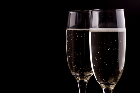 gold flute: Photo of a glass of champagne on black background