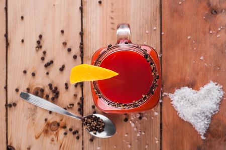 Photo of bloody mary cocktail on wooden table Stock Photo