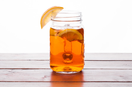 Foto van Hot gekruide thee in pot op houten tafel Stockfoto - 52262189