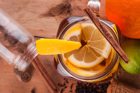spiced: Photo of Hot spiced tea in jar on wooden table