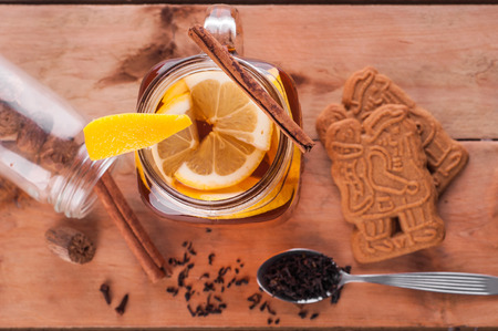 punch spice: Photo of Hot spiced tea in jar on wooden table