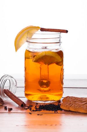 Foto van Hot gekruide thee in pot op houten tafel Stockfoto - 52262038
