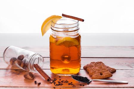 Foto van Hot gekruide thee in pot op houten tafel Stockfoto - 52261959