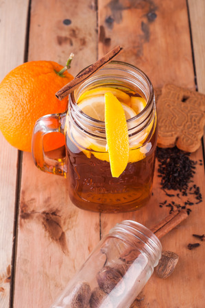 bisquit: Photo of Hot spiced tea in jar on wooden table