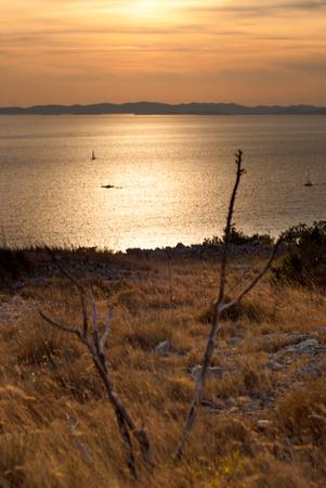 photo of Sunset over Kornati Islands, Croatia, Dalmatia. view from Murter, Raduc hill.