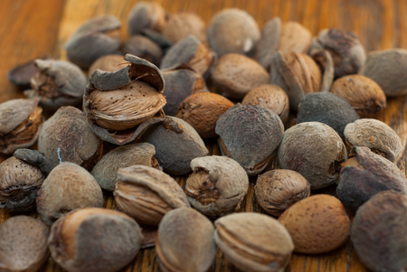 alergy: photo of raw almonds on the wooden background