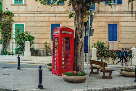 Photo of Red phone box in the streets of Malta Zdjęcie Seryjne