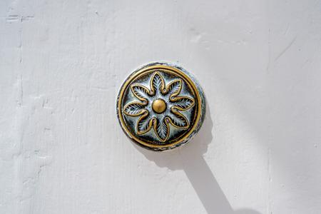 Photo of Traditional metal door handle on white wood door, Malta Zdjęcie Seryjne