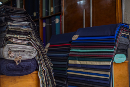 Photo of Rolls of textiles in a fabric shop. Multi colors and patterns. Zdjęcie Seryjne