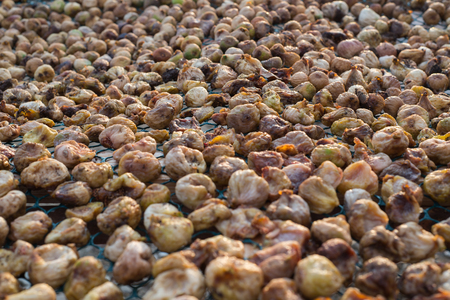 Dried figs background. Photo of dry, natural figs.
