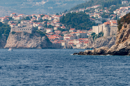 Photo of old harbour and fortified old town in Dubrovnik, Dalmatia, Croatia. View from Lokrum Island. Zdjęcie Seryjne