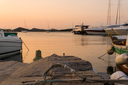 Photo of The small harbour of the Murter city on the island Murter in Croatia with wooden fishing boats  Zdjęcie Seryjne